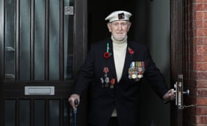 Malcolm Clerc, a World War II veteran, observes the two-minute silence at his home in Knutsford in Cheshire