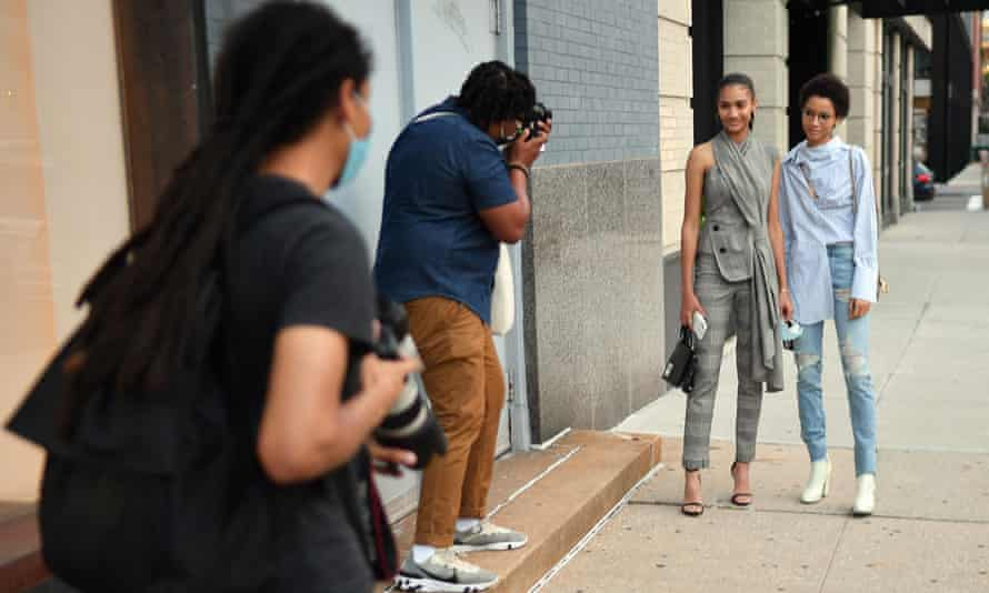 "Models being photographed outside the Monse show in New York. Photographer Andrew H Walker says the atmosphere has been ""lacklustre""."
