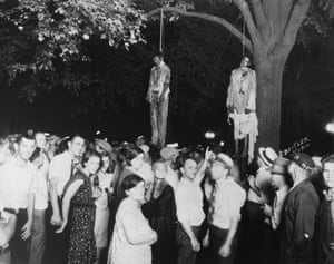 A crowd gathers after the lynching of two young African-American men who were taken from the Grand County Jail and lynched in the public square.