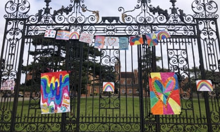 Homemade rainbow signs are displayed on the gates of Carew Academy school in Wallington during lockdown in April 2020.