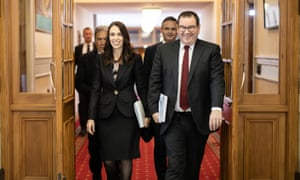 New Zealand's PM Jacinda Ardern and finance minister, Grant Robertson, walk to the house of parliament on budget day.