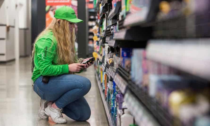 An Amazon worker on a tour of the company's new cashless supermarket in Seattle.