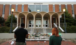 Students lay candles and flowers at the steps of Kennedy Hall on Wednesday to honor the victims of the shooting.