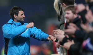 Danny Cowley, the Lincoln City manager,celebrates with supporters after their 2-2 draw at Ipswich