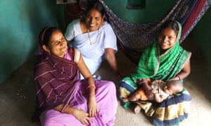 Health workers Vimla Gochar and Lata Nayar visit new mother Nirmala