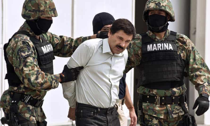 """Mexican drug trafficker Joaquín """"El Chapo"""" Guzmán is escorted by marines in 2014."""