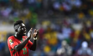 Aldair applaudes the Guinea-Bissau supporters at the end of the match.