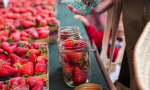 Taking a reusable mason jar to a farmers' market will help cut down on packaging.