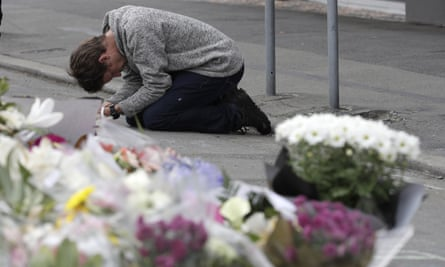 Mourner prays near Linwood mosque in Christchurch