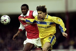 Kewell holds off Arsenal's Patrick Vieira