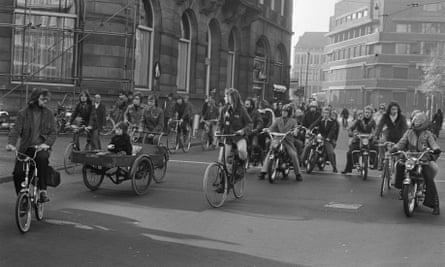 Cyclists, moped riders and a cargo bike on a car-free crossing, Amsterdam, 1973.