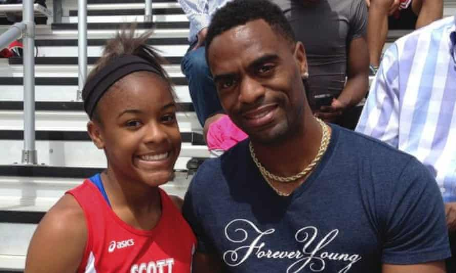 Trinity Gay poses for a photo with her father Tyson Gay in 2014. Trinity was believed to be caught in exchange of gunfire between two vehicles in a car park.
