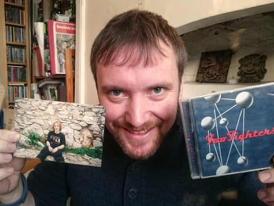James Eaton with a photo of his 1997 self and Foo Fighters' second album.