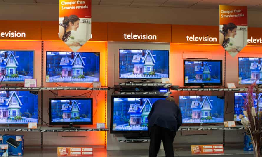 Man looking at televisions in BrightHouse shop