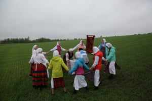 Belarussians in traditional attire celebrate the pagan rite Yurya in the village of Obchin.