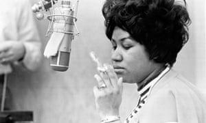 Soul singer Aretha Franklin in a recording studio smoking a cigarette