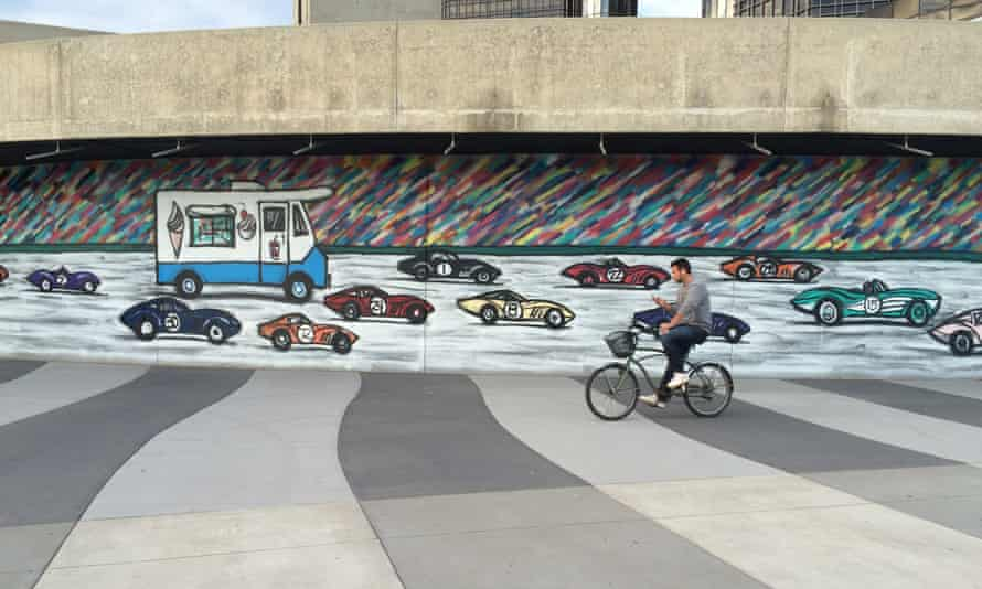 A mural on Detroit's regenerated riverside. Cycling has increased 400% in the city since 2000.