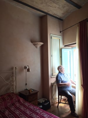 Papa looking at the view of Petritoli from hotel room