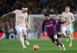 Messi nutmegs Jones as he goes by.