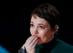 Olivia Colman accepts the Best Actress award for her role in The Favourite.