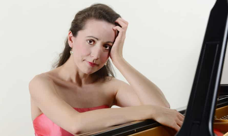 maria marchant seated at a piano in close up