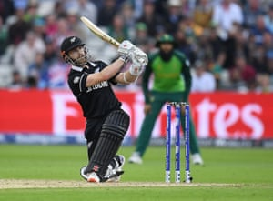 Thwack! Kane Williamson of New Zealand hits a six to bring up his century.