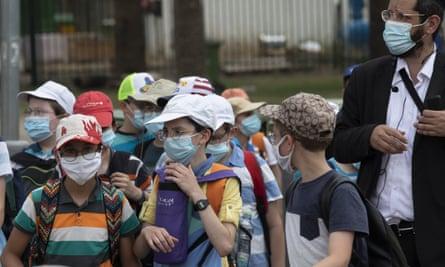 Israeli school children wear face masks to help prevent the spread of the coronavirus as they walk in Tel Aviv last week.