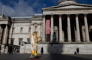 A street performer dressed as Star Wars character Yoda entertains passers-by in front of the National Gallery in Trafalgar Square, London.