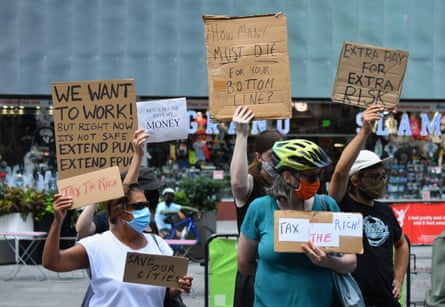 Protesters rally demanding economic relief during the coronavirus pandemic, at Time Square in New York City on 5 August.