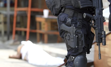 Police guard the scene of a murder after a man was shot to death in Acapulco, Mexico, on 2 January.