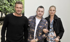 David Beckham and Kate Moss flank Kim Jones backstage at the designer's show