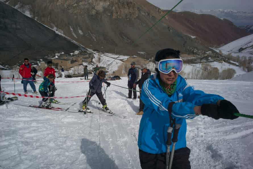 Nazira holds the tow-rope as she is taken up the ski hill during a day of practice.