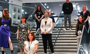 First minister Nicola Sturgeon wears a tartan face mask during a visit to Ford Kinaird retail park in Edinburgh, Scotland.