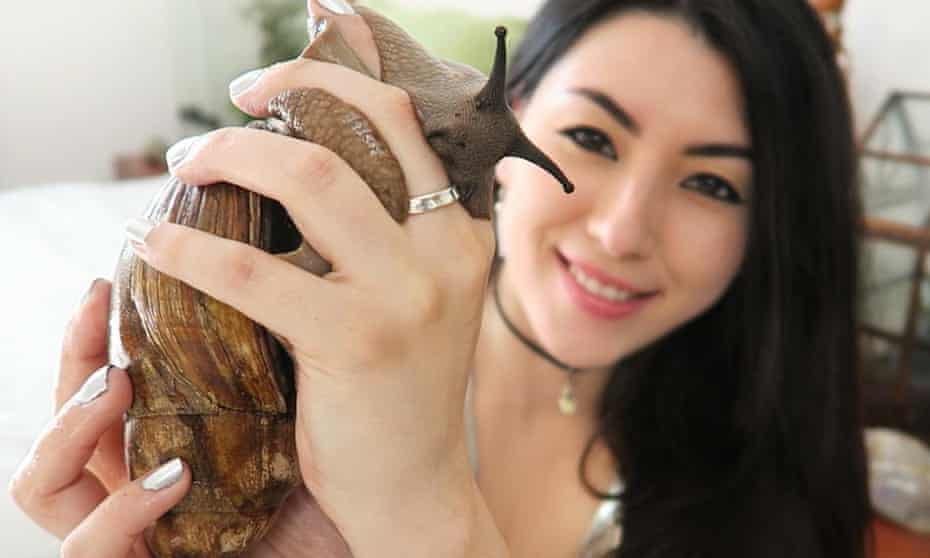 Emma Jacobs with a giant snail