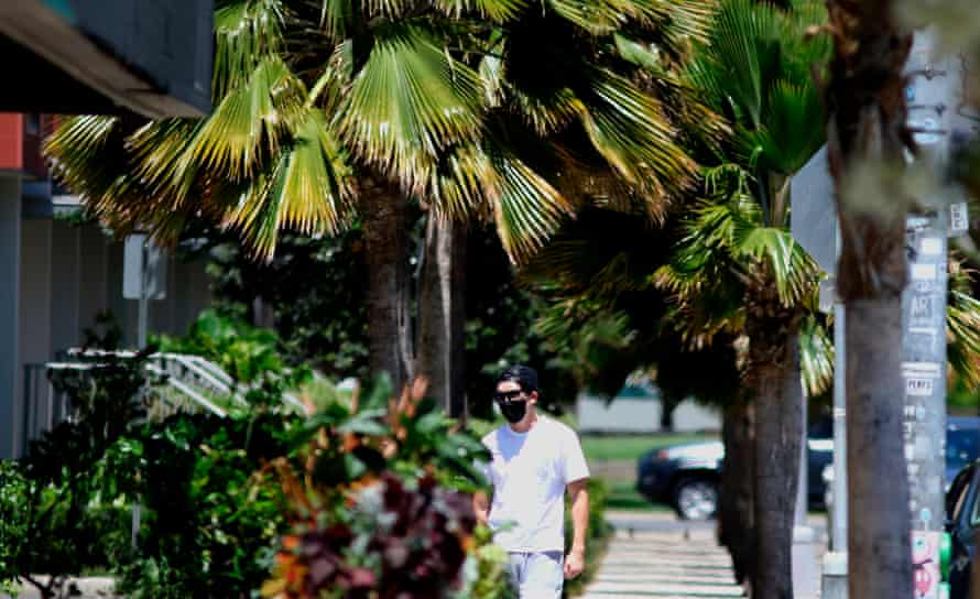 A man wears a mask as a precaution against the coronavirus in Honolulu.