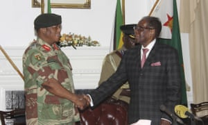 Robert Mugabe, right, shakes hands with General Constantino Chiwenga.