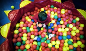 child in sure start ball pool