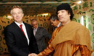 Tony Blair shakes hands with Colonel Gaddafi following talks with the former Libya leader in Sirte in May 2007.
