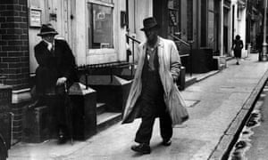 'You bounce up a kind of misery and pathos' … a man walking a London street in 1949.