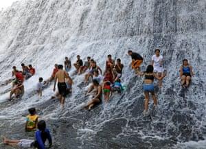 Rodriguez, Rizal, Philippines. People take a dip in the Wawa dam