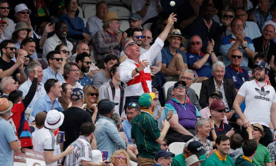 An England fan throws the ball back after England's captain, Eoin Morgan, smashed a six into the stands at the Oval.