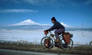 Rob Penn cycling, with Mount Ararat in Iran, near the border with Turkey, behind him