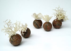 Eum Norr (dying reef) (2020) by Jimmy K Thaiday. Stoneware with underglaze slip, and ghostnet rope. A finalist in the 2020 Natsiaa Indigenous art prize.
