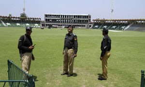 Pakistani police officers take part in a security rehearsal at Gaddafi stadium in Lahore.