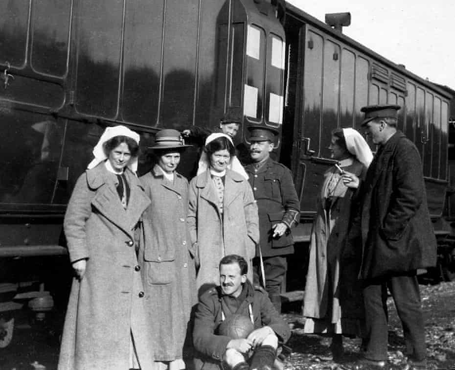 RAMC (Royal Army Medical Corps) doctors and nurses taking a break from working on the ambulance train which went to and from the front. The train was hit by a bomb during a heavy raid in Etaples in June 1918. It caught fire but luckily no one was killed or badly injured.