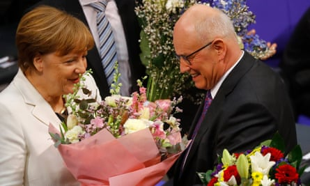 Angela Merkel is congratulated after being voted in again as German chancellor at the Bundestag in Berlin.