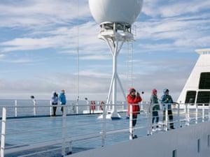 Passengers on board the Ocean Atlantic watch as the vessel nears Point Wild