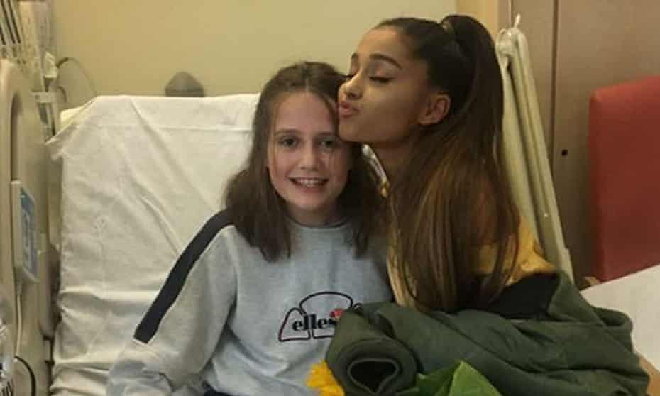 Ariana Grande meets Evie Mills during a visit to injured fans at the Royal Manchester children's hospital ward.