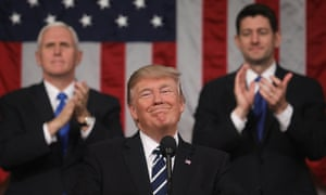 Mike Pence and Paul Ryan applaud as Donald Trump delivers his first address to Congress in February 2017.