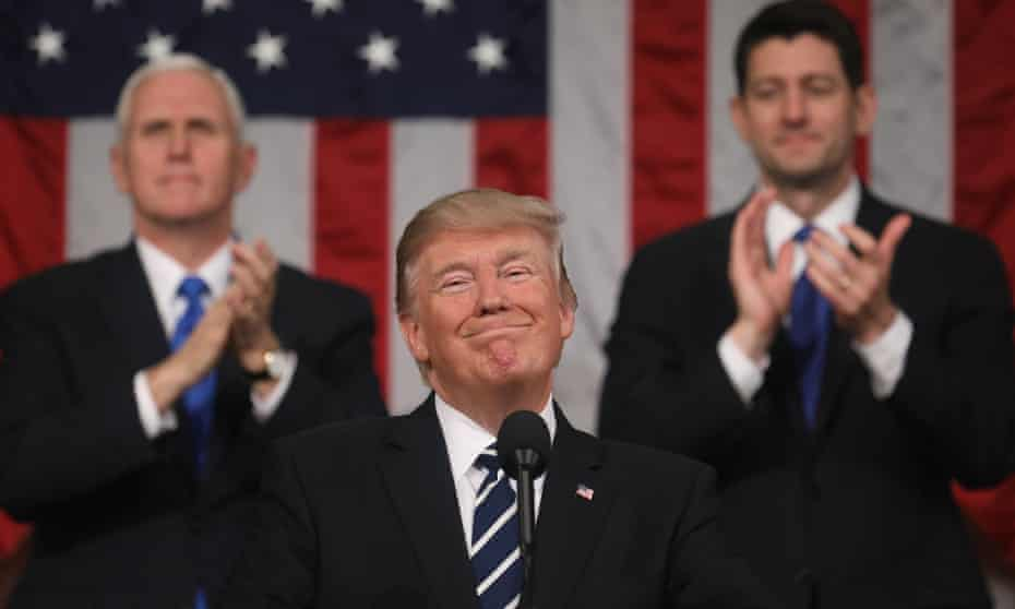 Mike Pence and Paul Ryan applaud as Donald Trump delivers his first address to a joint session of Congress.